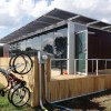 House with Cylindrical Solar Panels and Ingenious Compact Design