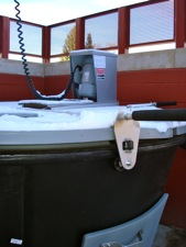 Earth Tub with auger and handles to turn the auger throughout the composting mixture