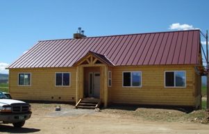 Beetlekill log home with few windows on the north facing side of the house
