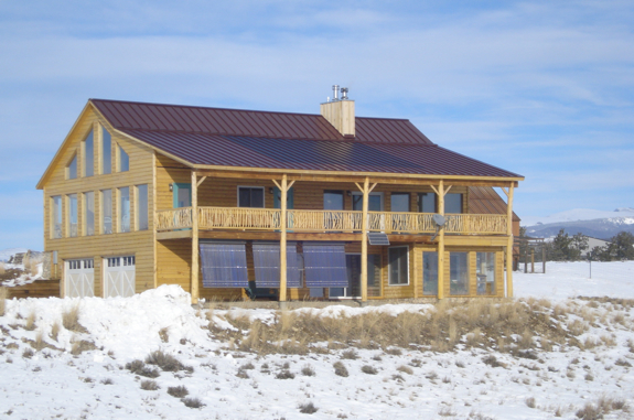 Active Solar House Plans net-zero log home uses both active and passive solar elements