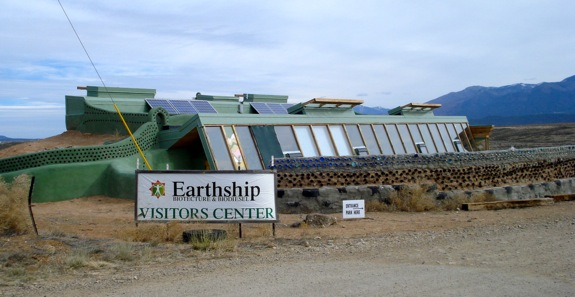 The Earthship Visitor's Center, with its southfacing slanted glass and a wall made from recycled botles and cans