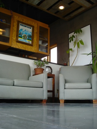 A poured cement floor gleams in the front room, while it also absorbs solar heat.