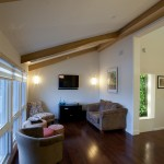 A vaulting ceiling and biowall help to keep the air clean in the living room.