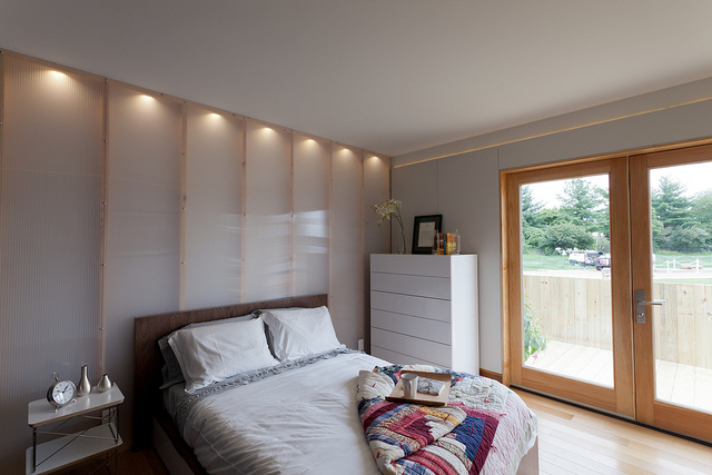 Bedroom with LED wall lighting