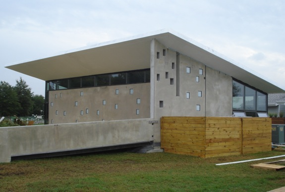 A modernist sleek concrete active passive solar home Precast concrete residential homes