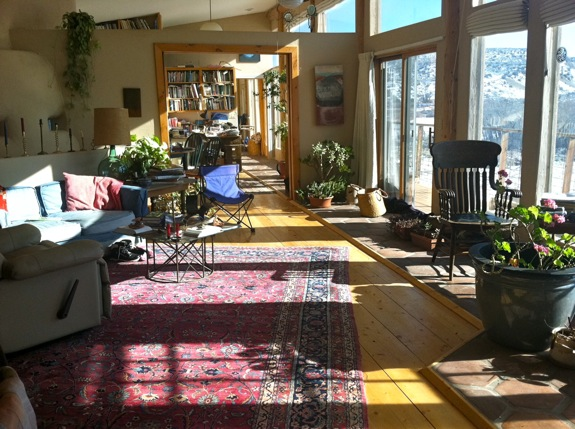 A passive solar house seen from inside the windows near the winter solstice.