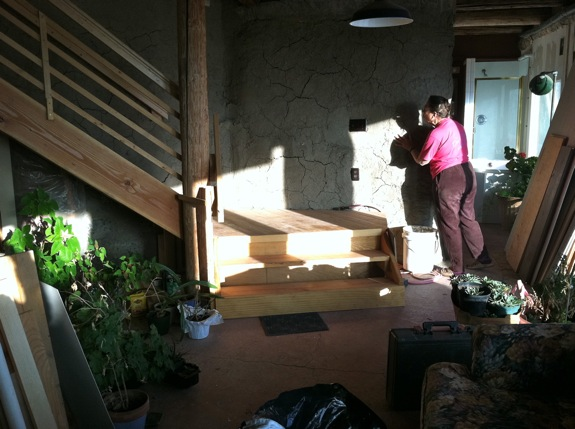 The inside wall of an earthship style wall