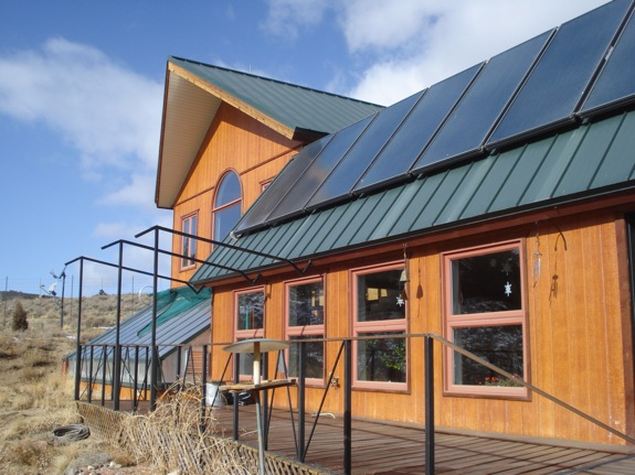 Solar panels, greenhouse, and southern facing windows make an efficient house.