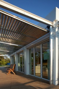 A steel frame attached to the house was a guide for the aluminum shades that protected the house.