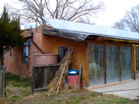 A passive solar greenhouse was added to the front of the house.