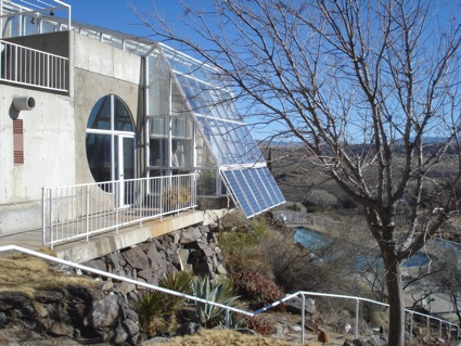 The solar panels and the pool at Arcosanti