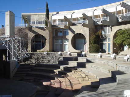 Amphitheater performance area surrounded by private residences.