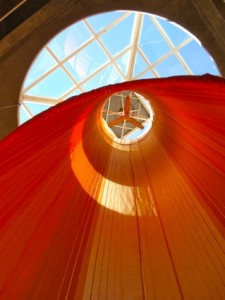 A fabric tube that transfers heat from above to the living area below.