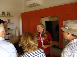 A UNLV Solar Decathlon team member tells visitors about the design and energy efficient features of the home.